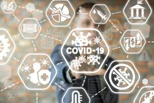 iconos relacionados con Covid-19 en una pantalla digital
