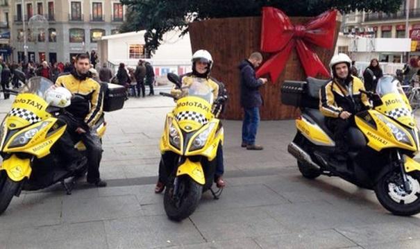Imagen de moto-taxis en la Puerta del Sol.   MotoTax1lowcost
